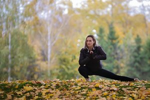 Girl gymnast stretching her legs in