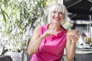Beautiful blonde woman making up usi