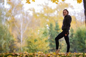 Fit gymnast girl standing in autumn
