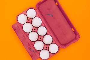 top view of chicken eggs in violet e