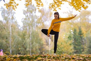 Girl in sweater doing acrobatic