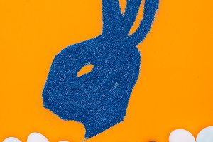 top view of bunny made of blue sand