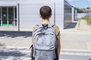 Teenage school boy with a backpack o