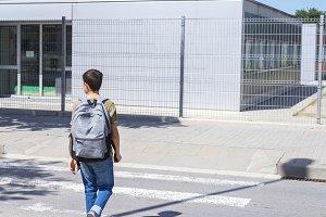 Teenage school boy with a backpack o