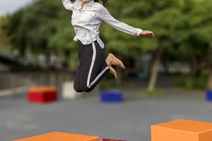 Young handsome black hair woman jump