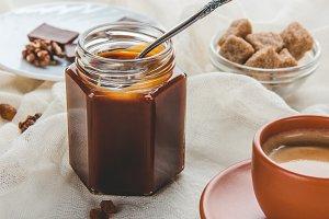 appetizing jar of caramel jam and cu