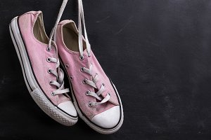 pair of pink textile sneakers
