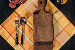 top view of wooden boards with fork