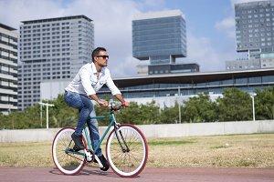 Young Man Biking in a Summer Day