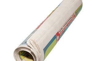 Rolled newspapers isolated on white