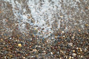 Wave, foam and textured stones