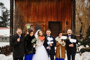 Wedding couple with friends and fake