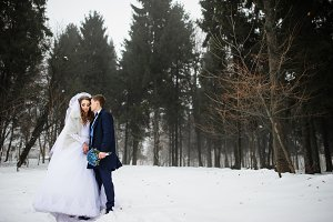 Young stylish wedding couple at fore