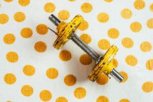 Yellow antique weights on a polka do
