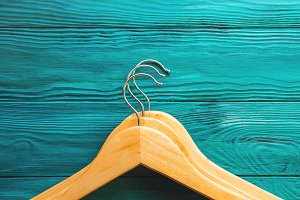 Wooden hangers on green background