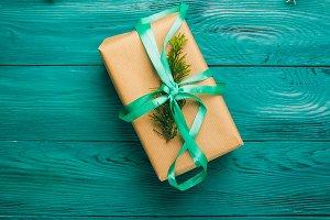 Christmas gift box on green