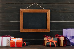 blank chalkboard in frame with gift