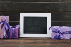 blank blackboard in frame with gift