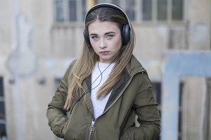 Young girl with headphones standing