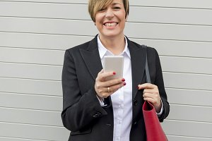 Executive working with a mobile phon