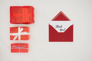 top view of red envelope with THANK