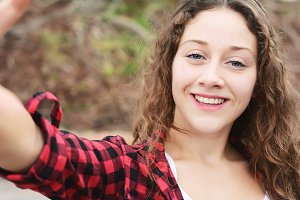 Young woman making selfie.