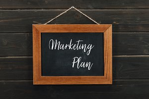 Board with lettering marketing plan