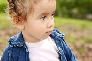 Portrait of baby girl in park.