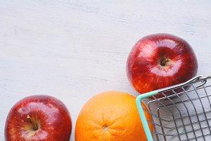 apple and orange with Shopping baske