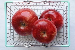 Basket with red apples.