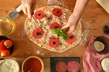 woman hands cooking pizza at home