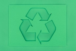 top view of green recycle sign with