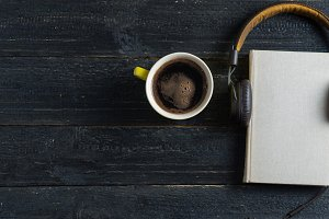 Audio book with headphones and coffe