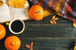 A mug of hot coffee, a warm scarf an