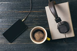 Audio book concept. Headphones, coff