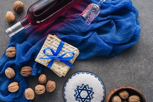 top view of matza, kippah and wine,