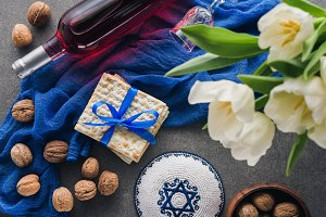 top view of kippah, matza and wine,
