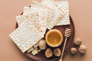 top view of matza with honey on tray