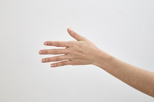 empty female hand on white