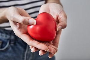 Red heart shape in the hands