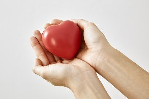 Red heart shape in hand