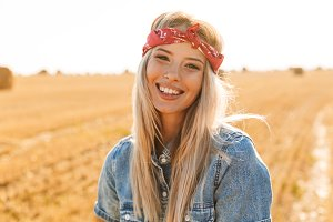 Smiling young blonde girl in headban