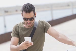 Man wearing sunglasses using phone o