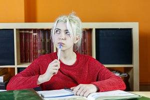 Attractive young blonde woman studyi