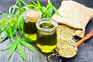 Oil hemp in two jars and flour