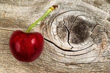 Single large Black Cherry on wood