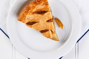 Fresh Baked Apple Pie slice on white