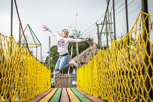 Young woman jumping on a colorful