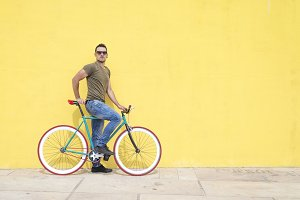Man posing with his fixed gear bicyc
