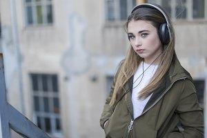 Teen posing listening to music weari